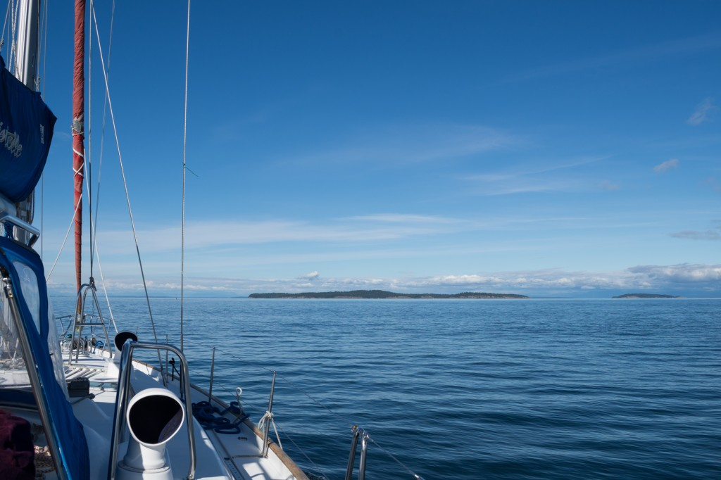 Motoring on smooth seas, Sucia Island off the starboard bow
